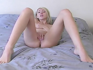 Amateur blonde masturbating