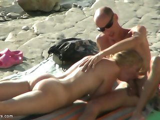 A nudist couple have fun at the beach. Full amateur sex video.