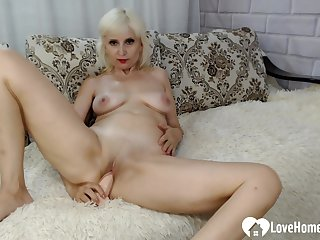 Lusty blondie shoves a toy into her vagina