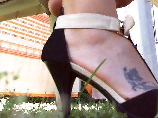 Loves my feet in these high heels as I walk through a garden