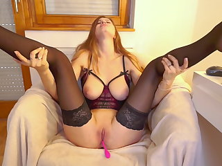 BLONDE IN SEXUAL CORSET SHOWING TITS AND JERKING OFF